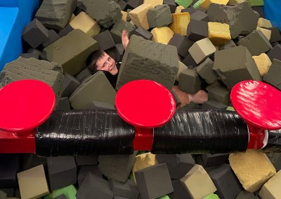 Boy having fun in foam pit