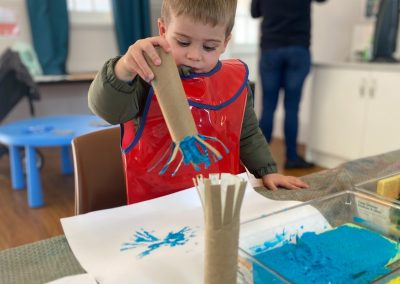 20210719-Early-Links-Playgroup_0003_Boy-pinting-with-rain-stick