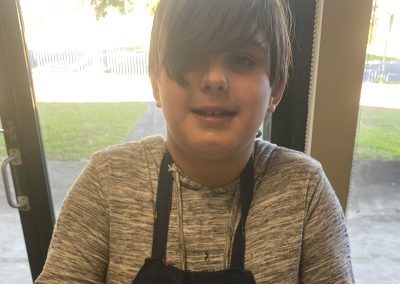 Happy young chef at cooking group