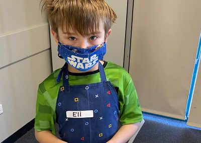 Young baker wearing a star wars mask at cooking group