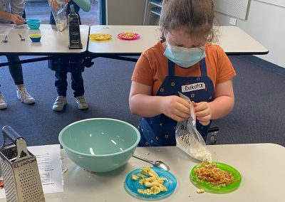 Making muffin mix at cooking group