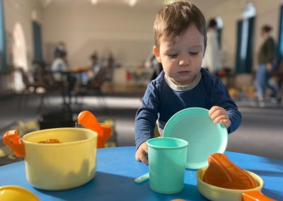 Boy playing with cooking toys