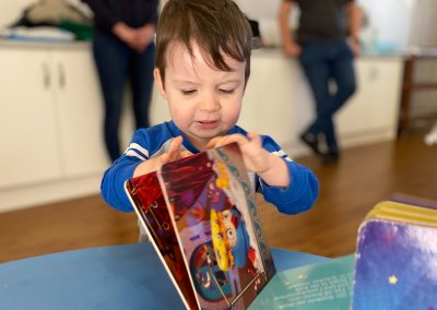 Boy turning pages of book