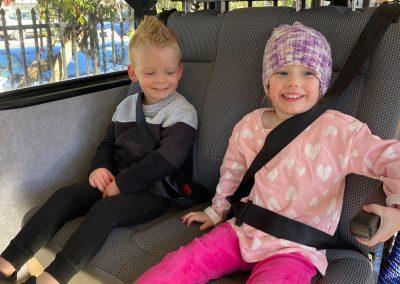 2 children having fun on the bus