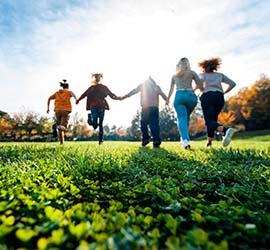 2021 Wellness Challenge Participants Run Across Sunny Field